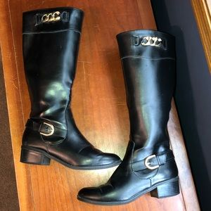 Black leather riding boots.